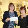 Helen Kelly receiving the cheque from John Lewis