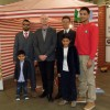 Desh Supermarket director Abul Hussain with his sons, Norwich City footballer Jeremy Goss, Nikhil Desai of Shana Foods and a supermarket staff member at the charity evening.
