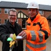 John Archibald of Victory Housing Trust (left) receives the keys to new homes in Cromer from Martin Weavers of Norfolk Homes.