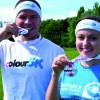 Events Manager Dan Bell and fundraising administrator Lauren Self with sweatbands and medals given to all participants in the Big C Colour 5K.jpg