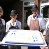 The team at HV Graves with the cake which is to be served to diners at the Aylsham Show ball.