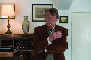 John Hurt as agent Francis Bonar