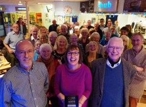 Theatre chairman Richard Ellis, president Lord Walpole and director Debbie Thompson with volunteers and supporters celebrating its Norfolk Arts Award before the annual meeting.  PICTURE: RICHARD BATSON.